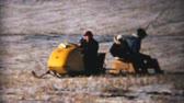 sanki : A family enjoys a beautiful winters day snowmobiling at the family farm in 1964.