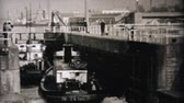 old metal texture : A fishing boat goes through the locks in Seattle, Washington in 1940. Stock Footage