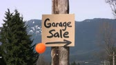 duyurmak : A home-made Garage Sale sign done with a black marker complete with a colorful orange balloon.