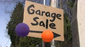 duyurmak : A home-made Garage Sale sign done with a black marker complete with a colorful balloons.