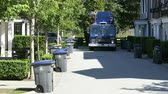 coletor : A new modern garbage truck comes to collect the trash in a suburban townhouse community. Vídeos