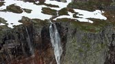 norueguês : Aerial footage of amazing waterfall in Norway on sunny day near popular Trolltunga rock. Aerial 4k Ultra HD.