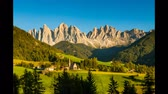 val di funes : Timelapse footage of picturesque village of St Magdalena in Italy with peaks of Dolomites towering above on sunny summer day which turns into starry night
