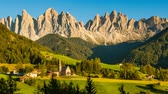 val di funes : Timelapse of shadow slowly covering scenic village St Magdalena in Italian Alps on sunny summer evening turning into starry night