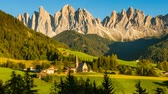 val di funes : Motion timelapse of famous view in Italian Alps as sunny day turns into dark starry night in Val di Funes, St Magdalena village Stock Footage