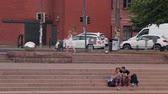 quiet : Helsinki. Finland - August 11: A couple in love sitting on the steps