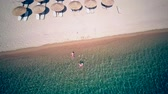 Family on beach aerial shot, Sithonia, Greece