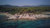 Man on rocky beach aerial shot, Sithonia, Greece Stock Footage
