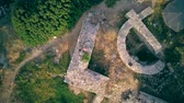 Man on castle ruins aerial shot, Sithonia, Greece