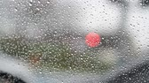 Raininess.  Raindrops on window glass and car traffic