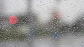 Raindrops on window glass and car traffic Stok Video