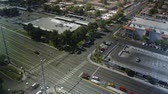 intersection : this is a birds-eye view of a busy intersection in Las Vegas shot in true time-lapse with proper motion blur.  A day shot transitions into a night shot.  Use either shot or combine the two.  Very versatile shot for establishing a scene. Stock Footage
