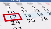 calandra : Date pointer moving over pasteboard calendar, close up