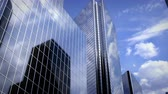 integration : Airplane flying over business center under cloudscape Stock Footage