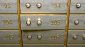 anahtar deliği : A door of safety deposit box with gold bars inside opened by two golden keys Stok Video