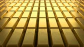que vale a pena : Loopable video of aligned rows of fine gold bars.