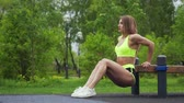 push ups : Athletic girl exercise the triceps on bench