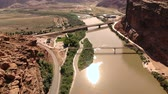arc : The City of Moab Utah, United States. Red rock landscapes, Colorado River. Aerial view, from above, drone shot