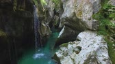 river rapids : AERIAL: Emerald water running through the narrow canyon