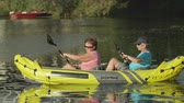 veslo : SLOW MOTION CLOSE UP: Happy mature couple kayaking on beautiful lake on sunny summer day