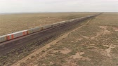 gasoline tank : AERIAL: Long container freight train transporting goods across the country Stock Footage