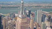 américa central : AERIAL CLOSE UP, ZOOM LENS, ESTABLISHING SHOT: Flying around iconic Empire State building in sunny New York city with midtown Manhattan, Hudson river and central park in the background. Stock Footage