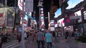 vezes : NEW YORK USA - SEPTEMBER 23rd 2016: HYPERLAPSE FPV Walking through busy crowded Times square at night, full of bright billboards flashing above peoples heads. Tourists and locals mingling and rushing