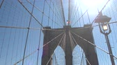 스코틀랜드 : CLOSE UP: Stunning Brooklyn Bridges cable arrangement formed in a distinctive web­like pattern illuminated by shining sun. Limestone, granite blocks and cement built towers with waving American Fl 무비클립