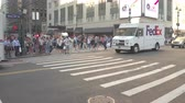 xing : NEW YORK, USA - SEPTEMBER 28: HYPERLAPSE. Busy crowded New York City streets during the rush hour. People, tourists and commuters waiting on pedestrian crossing for green signal to cross the road