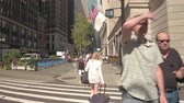 fpv : NEW YORK, USA - SEPTEMBER 28: HYPERLAPSE Walking along busy Broadway in multicultural New York City towards famous Central Park. Streets and sidewalk crowded with vehicles, people, tourists, commuters