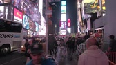 ônibus : NEW YORK, USA - SEPTEMBER 28: HYPERLAPSE. Masses of local people and tourists on brightly adorned with billboards and advertisements Times Square, a major commercial neighborhood in Midtown Manhattan Stock Footage