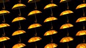 bez szwu : Orange Umbrellas On Black Background.Loop able 3D render Animation.