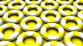 dovolená : Yellow swim rings on yellow background