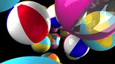 Colorful beach balls on black background.3D render animation.