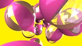 Pink beach balls on yellow background Stock Footage
