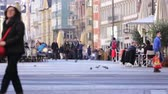 november : INNSBRUCK, AUSTRIA - NOVEMBER 1st 2015: Refugee begging for help in the streets of Innsbruck with people walking by.