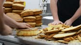stacking : pastry chef cutting the sponge cake on layers. Cake production process. Stock Footage