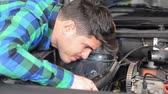 Mechanic repairing the engine. Checking auxiliary belt. Stock Footage