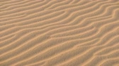 close up of sand dunes pattern texture in desert.