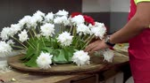 Florist at work. Male florist creating beautiful bouquet at flower shop. Close up . Стоковые видеозаписи