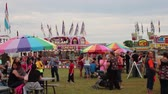 zíper : Wide View of the Carnival with rides and games and people walking around