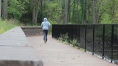 runners : Jogger on a Bridge in the Park Away from Camera