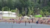 splash park : People at the Beach on a Hot Day