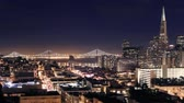 vadi : San Francisco-Oakland Bay Bridge lights and cityscape time lapse at night zoom Stok Video