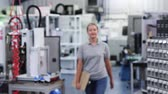 Slow Motion Portrait Of Female Engineer In Factory Walking Towards Camera Stock Footage