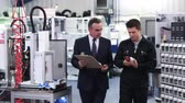 Business Owner In Factory Discussing Component With Engineer Stock Footage