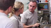 Engineer Teaching Apprentices To Use Lathe In Factory Stock Footage