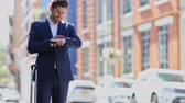 Businessman Using Mobile Phone App To Order Taxi Stock Footage