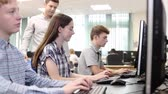 афроамериканца : Teacher Helping Female High School Student Working In Computer Class