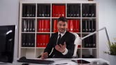 clap : Pov UHD. Single attractive young businessman clapping inside modern office with computer, keyboard, laptop, tablet pc, digital pad, documents. Applause Stock Footage